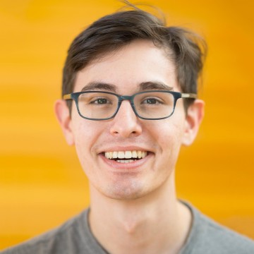 Headshot of man wearing glasses and smiling
